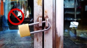 An example of a padlock with a long shackle used inappropriately, where it would have been much better to use a roller shutter padlock.