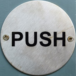 There are also 2 types of electric strikers with respect to the opening mechanism: one is opened simply by pressing the button, the other is opened if someone pushes the door whilst the button is pressed (photo by flickr/chrisinplymouth )