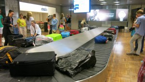 After a flight they are returned to a conveyor belt, unattended.